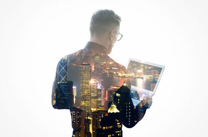Trader mit Laptop